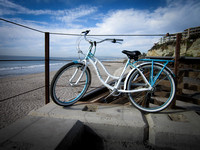 BLUE AND WHITE BIKE AT BEACH